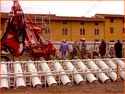 """In the so-called """"full intervention,"""" workers will use up to 40 tubes like these to extract soil from beneath the tower's north side, thereby causing the tower to lean a bit less."""